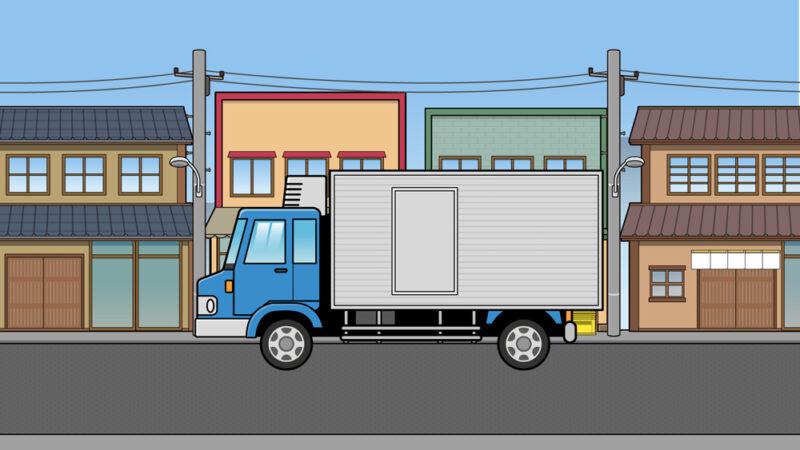昭和の町並みを走るトラックのイラスト