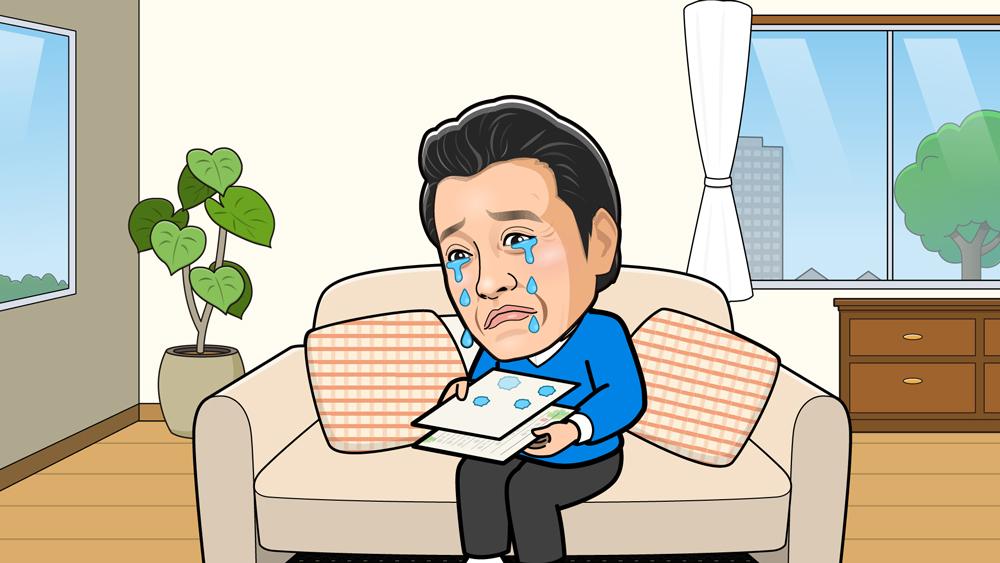 ソファーで手紙を読んで泣いている様子