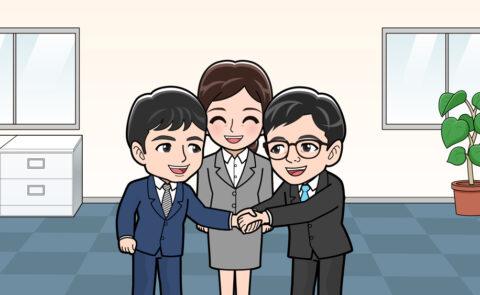 会社で握手する人
