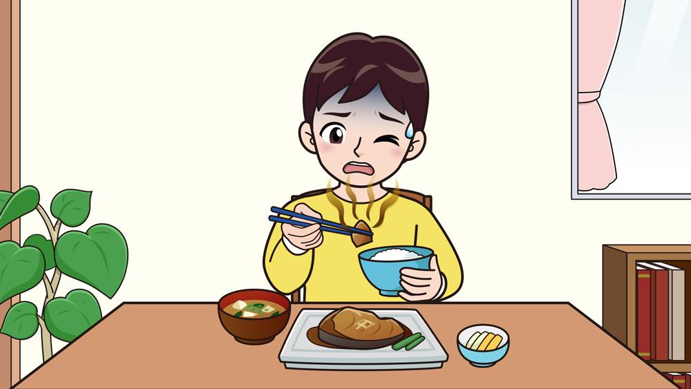 嫌いなものを食べる子供