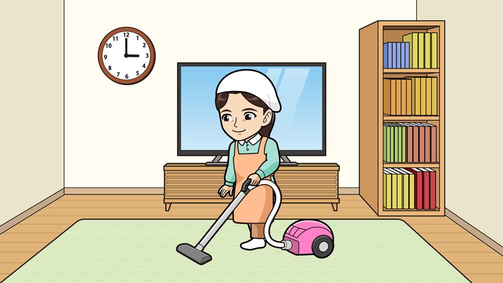 掃除機をかける人
