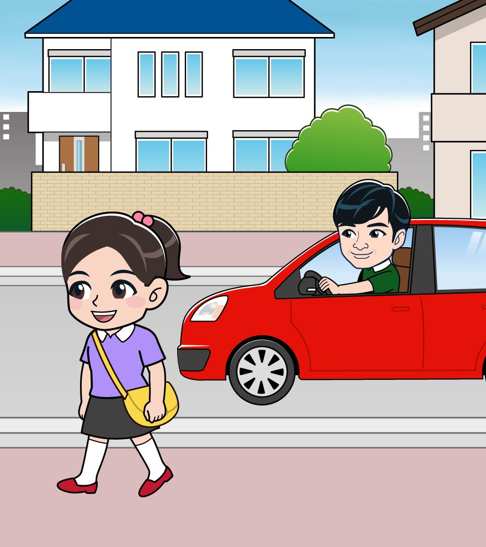 歩道を歩く女の子